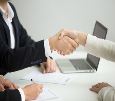 Two persons shaking hands following interview